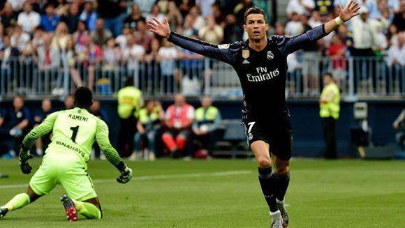 Cristiano abrió el marcador ante el Málaga en el minuto 2′ y encarriló el partido para ganar La Liga. Foto: AFP.